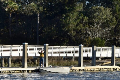 Mike raises his hands in victory at the boat ramp dock at Steamboat Landing.