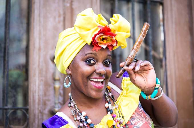 Cuba Travel Guide: How to spend 48 hours in havana - Afro Cuban woman with cigar