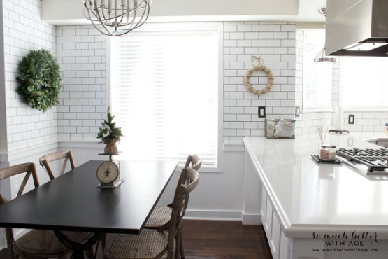 Subway tile in eating area of kitchen | somuchbetterwithage.com