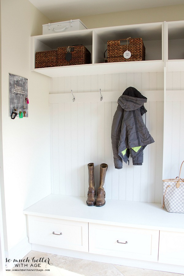 Laundry room built-in cubbies | somuchbetterwithage.com