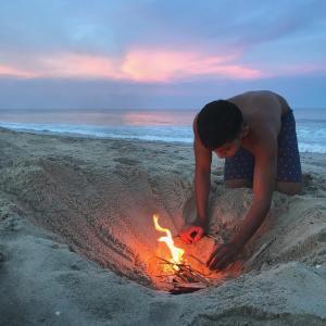 He is in heaven fire on the beach  hellip