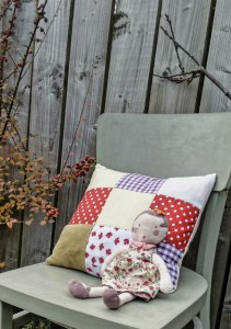 ALT=picture of a cushion and a doll