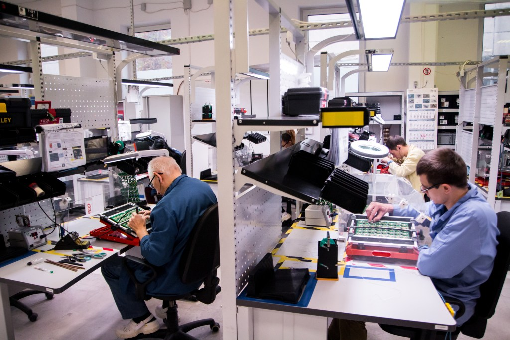 Three Men At Desks in Fibaro Electronics Manufacturing Facility – Toronto Vancouver