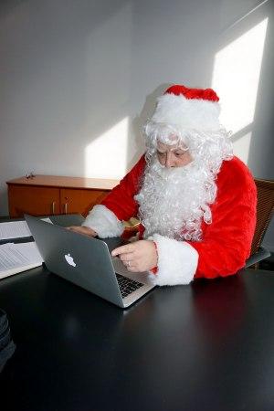 Santa sitting at Laptop
