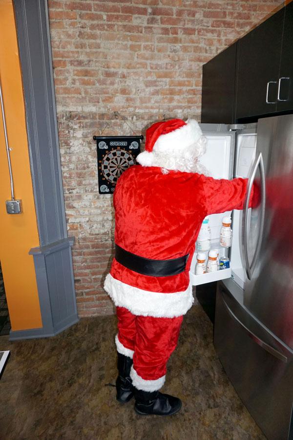 Santa looking in fridge