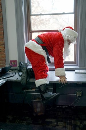 Santa crawling in window