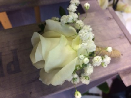 white rose and gyp buttonhole