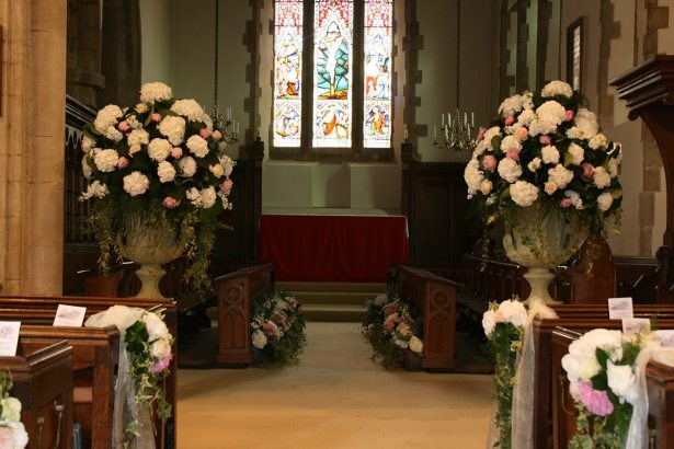 Large flower urns for a church ceremony