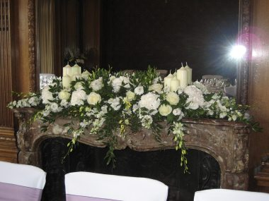 Mantelpiece flower arrangment with candles