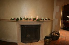 Mantlepiece flowers and candles at Le Manoir