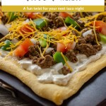 Baked taco pizza on a baking stone on a wooden surface (vertical with title and description overlay)