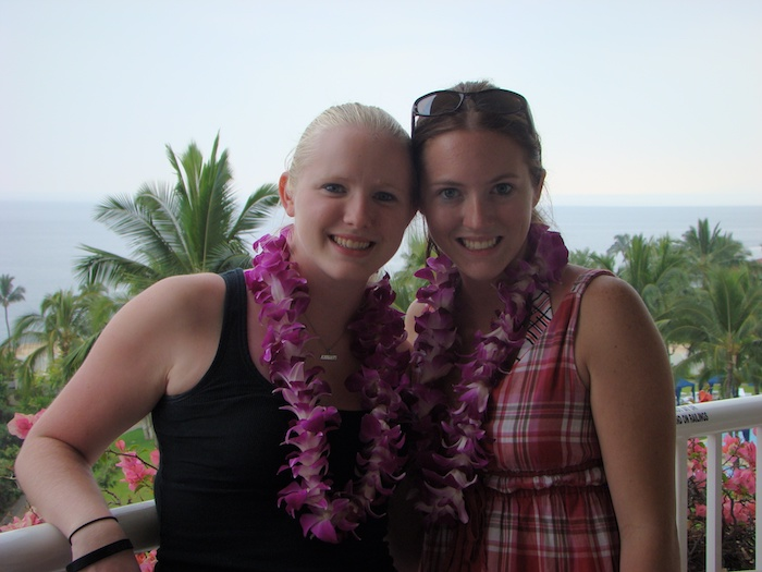 Two girls in Hawaii with flower leis