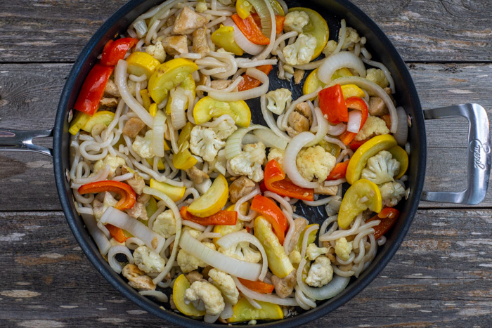 Summer Veggie Stir-Fry in a large skillet on a wooden surface