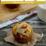 Strawberry Muffins with Applesauce on a piece of brown paper with a bamboo tray of muffins and a glass of milk behind all on a wooden surface (with title overlay)