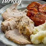Instant pot turkey with candied yams and mashed potatoes on a grey plate (with title overlay)