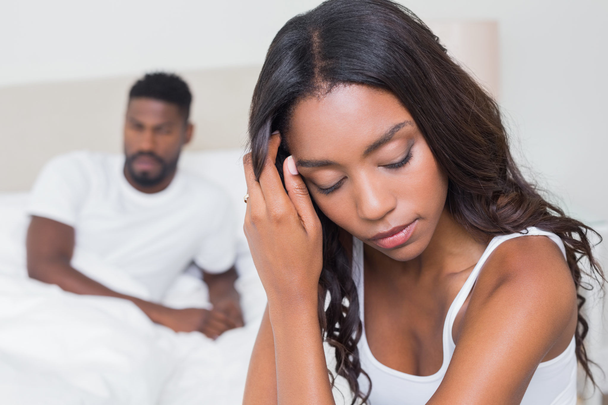 Upset couple not talking to each other after fight at home in bedroom