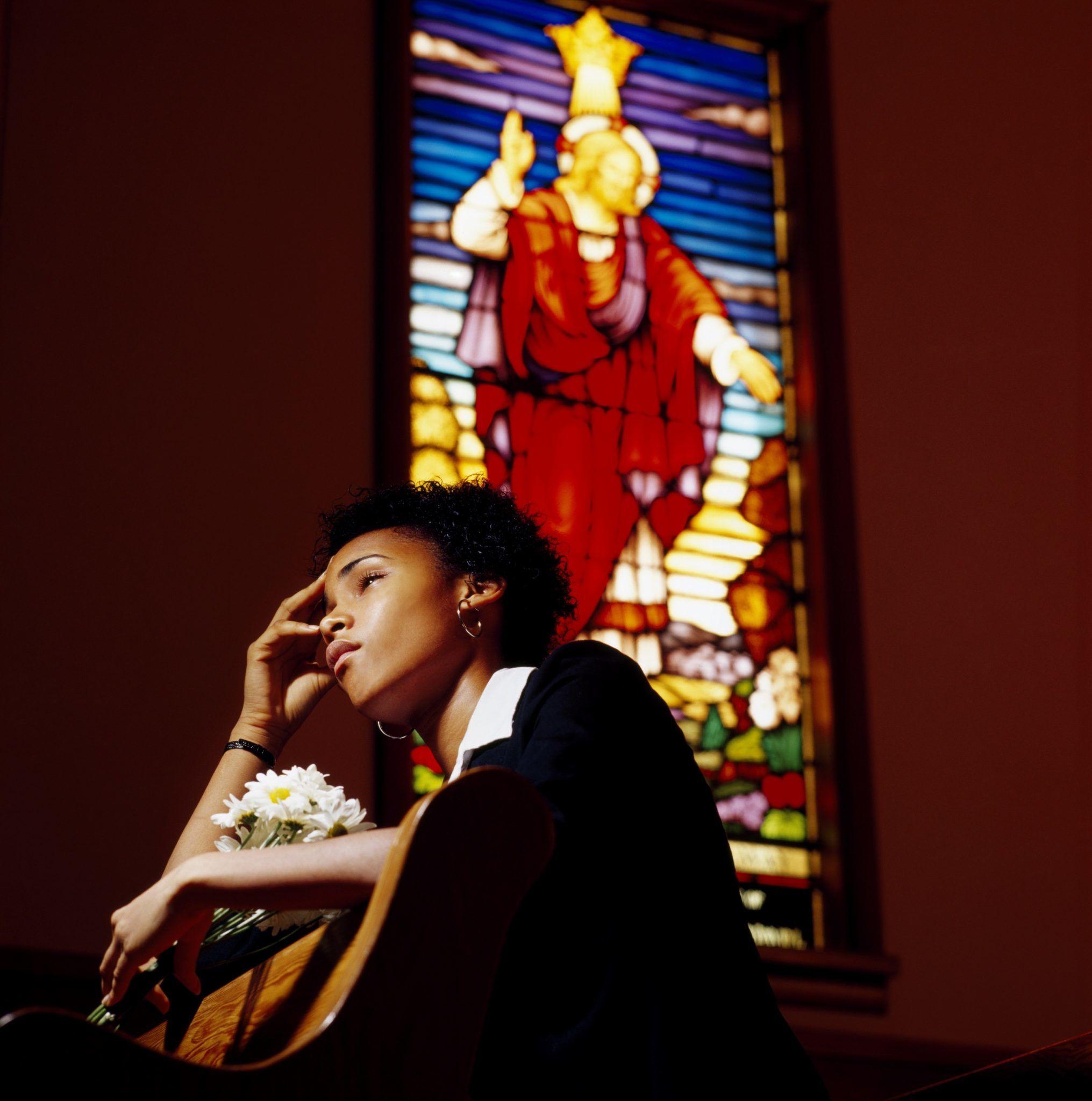7206708 – a sad woman in a church