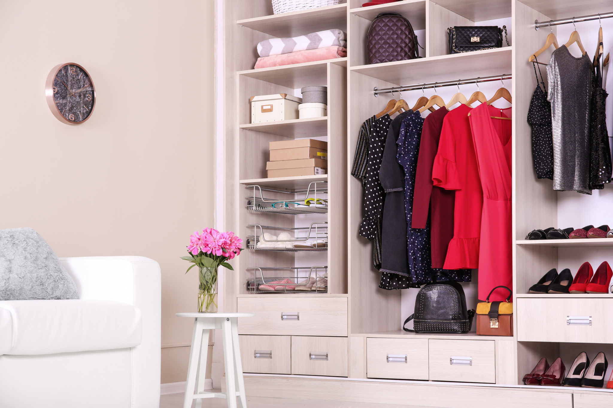 Modern wardrobe with stylish clothes in room interior