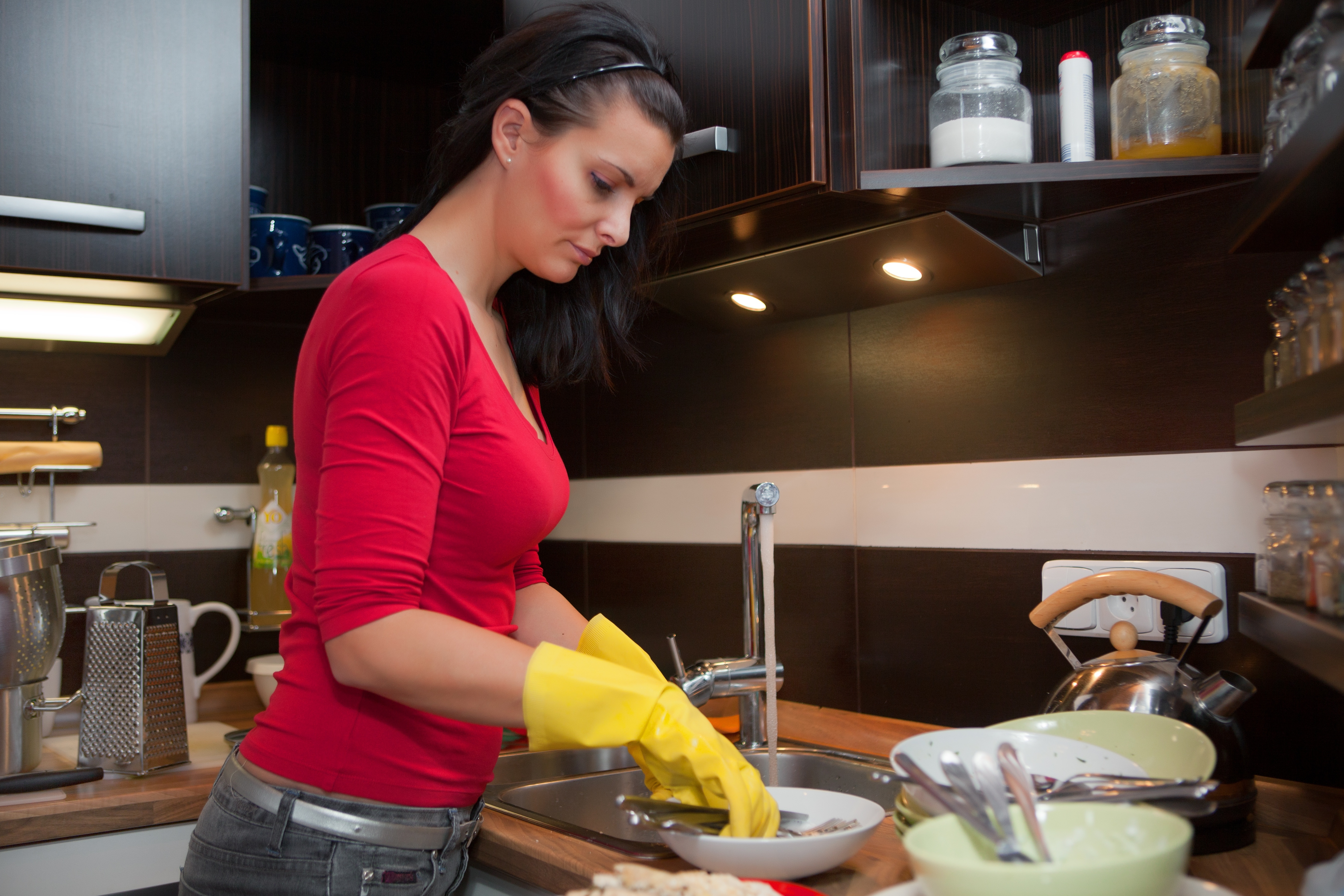 12684414 – young beautiful woman do the cleaning in kitchen