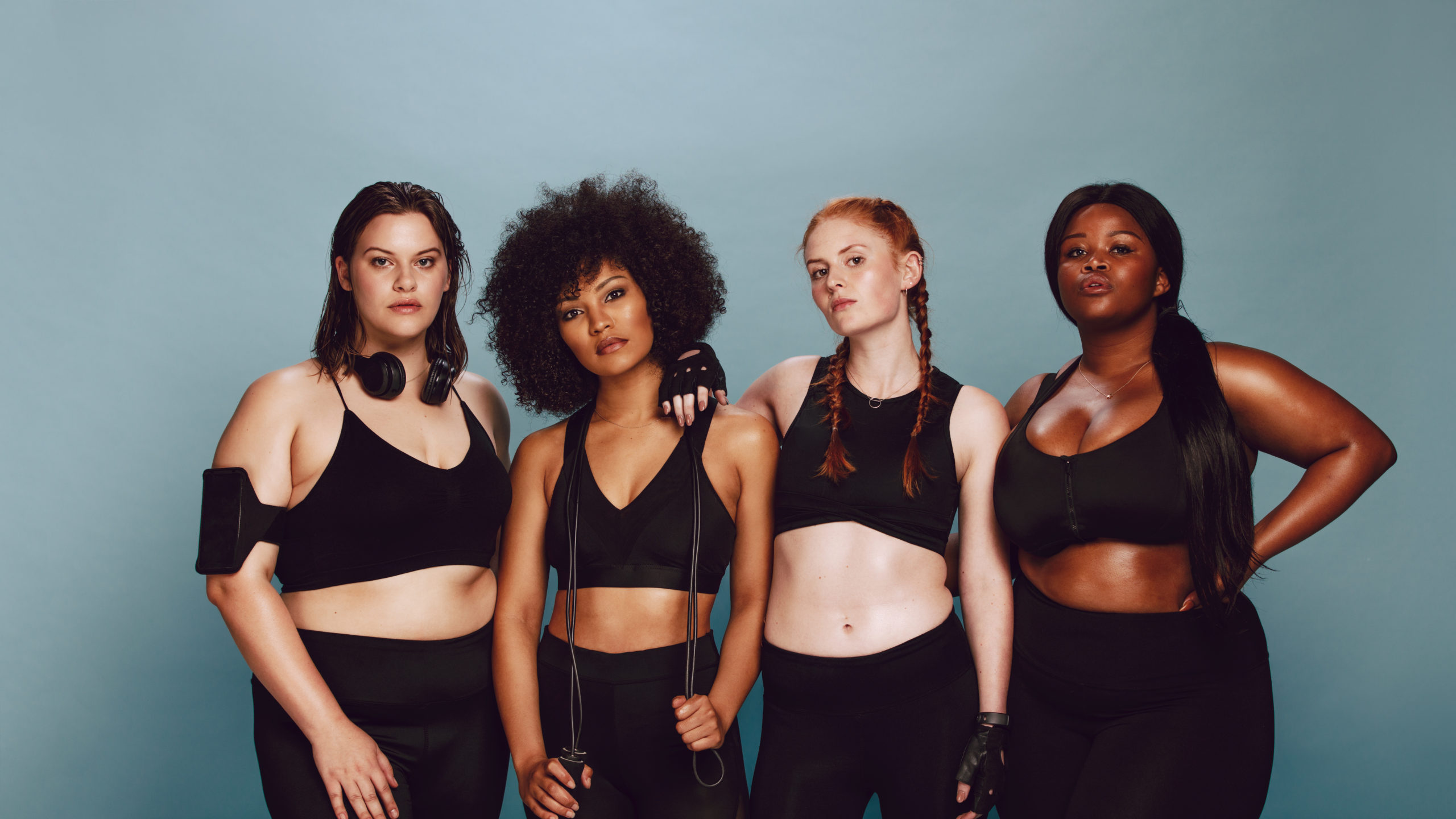 Group of women with different weights in sportswear