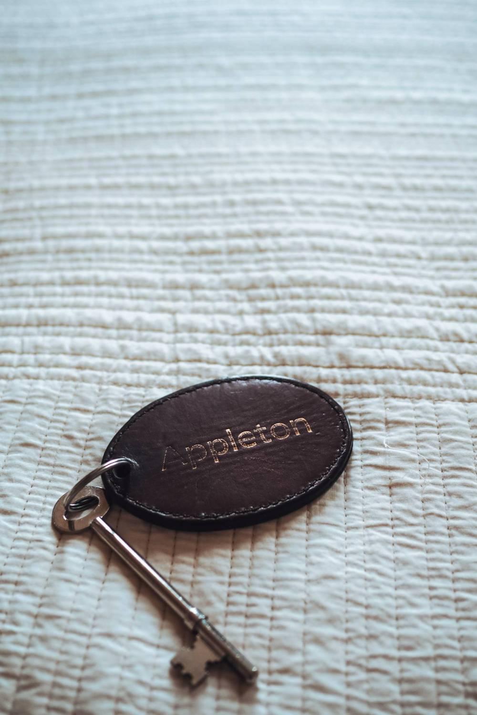 Door key on a leather keyring reading 'Appleton'