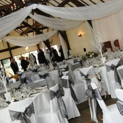 Cheap Black Chair Covers For Sale Hanging Wicker Chairs Canada Cover Hire Sash Bows Wedding Table Swagging Venue Striking And White Organza Double Over Cotton