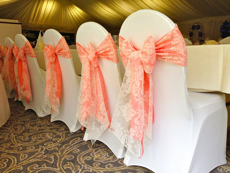 light pink spandex chair covers unfinished ladder back chairs cover hire sash bows wedding table swagging venue soft white stretch lycra