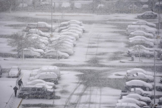 Vehicles are covered in snow in a parking lot in the northern border town of Ciudad Juarez
