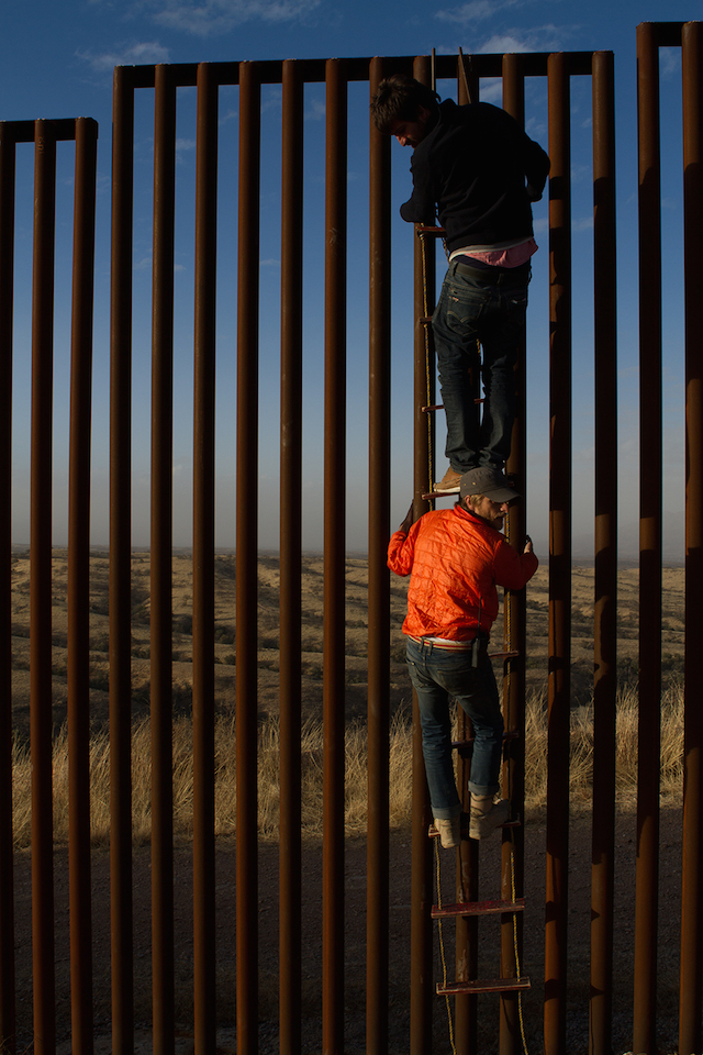 Marc-Silver-(director)-and-Thomas-Benki-(producer)-climb-the-border-wall---2011