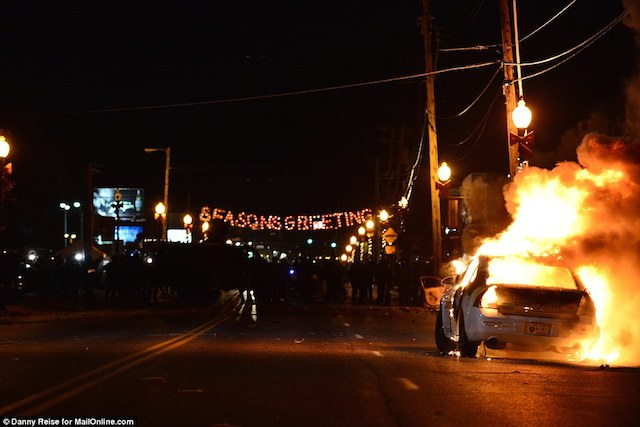 237B689800000578-2844491-Inferno_on_the_streets_At_the_Ferguson_Police_Department_in_Ferg-151_1416896402817
