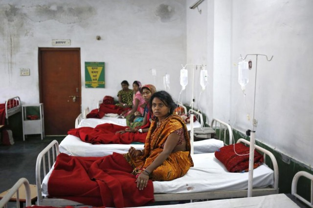 "Women, who underwent a sterilization surgery at a government mass sterilisation ""camp"", lie in hospital beds for treatment at CIMS hospital in Bilaspur"