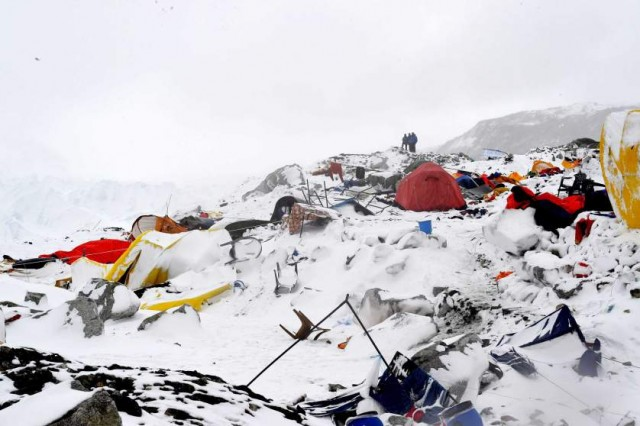 TOPSHOTS In this photograph taken on April 25, 2015, people look on at the devastation after an avalanche triggered by an earthquake flattened parts of Everest Base Camp.   Rescuers in Nepal are searching frantically for survivors of a huge quake on April 25, that killed nearly 2,000, digging through rubble in the devastated capital Kathmandu and airlifting victims of an avalanche at Everest base camp.   AFP PHOTO/Roberto SCHMIDTROBERTO SCHMIDT/AFP/Getty Images
