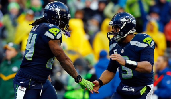 SEATTLE, WA - JANUARY 18: Marshawn Lynch #24 celebrates with Russell Wilson #3 of the Seattle Seahawks during the fourth quarter of the 2015 NFC Championship at CenturyLink Field on January 18, 2015 in Seattle, Washington. (Photo by Tom Pennington/Getty Images)