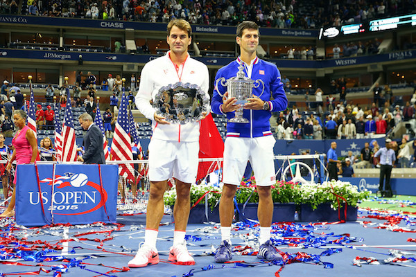 September 13, 2015 - Roger Federer and Novak Djokovic pose with trophies after the men's singles final match during the 2015 US Open at the USTA Billie Jean King National Tennis Center in Flushing, NY. (USTA/Ned Dishman)