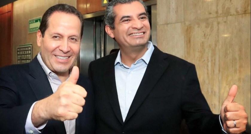 Eruviel Ávila y Enrique Ochoa, sonriendo de forma muy naturalita