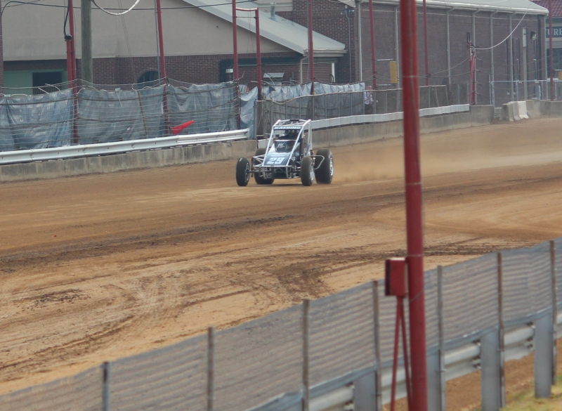 Bud Kaeding qualifies at Indy near the same spot in 2012; the track surface remains unchanged.