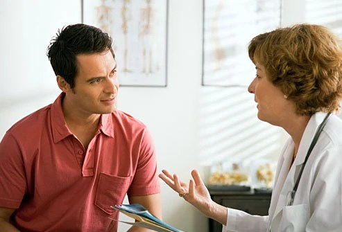 getty_rf_photo_of_man_talking_to_doctor
