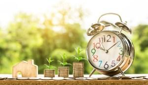 clock beside coins