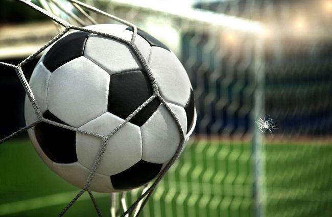 football. The ball flies into the net gate