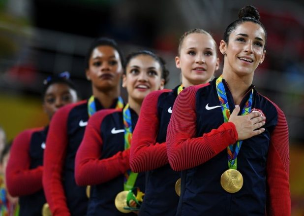 Gold Medalists Simone Biles, Gabrielle Douglas, Lauren Hernandez, Madison Kocian and Alexandra Raisman (from left) of the United States stand on the podium for the national anthem at the medal ceremony for the Artistic Gymnastics Women's Team Final on Day 4 of the Rio 2016 Olympic Games at the Rio Olympic Arena on Aug. 9, 2016, in Rio de Janeiro, Brazil. Laurence Griffiths/Getty Images