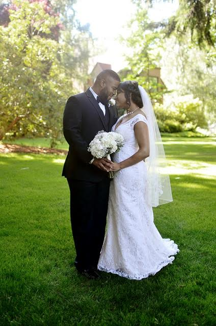 Bride and Groom Embrace on Wedding Day in Lush Garden