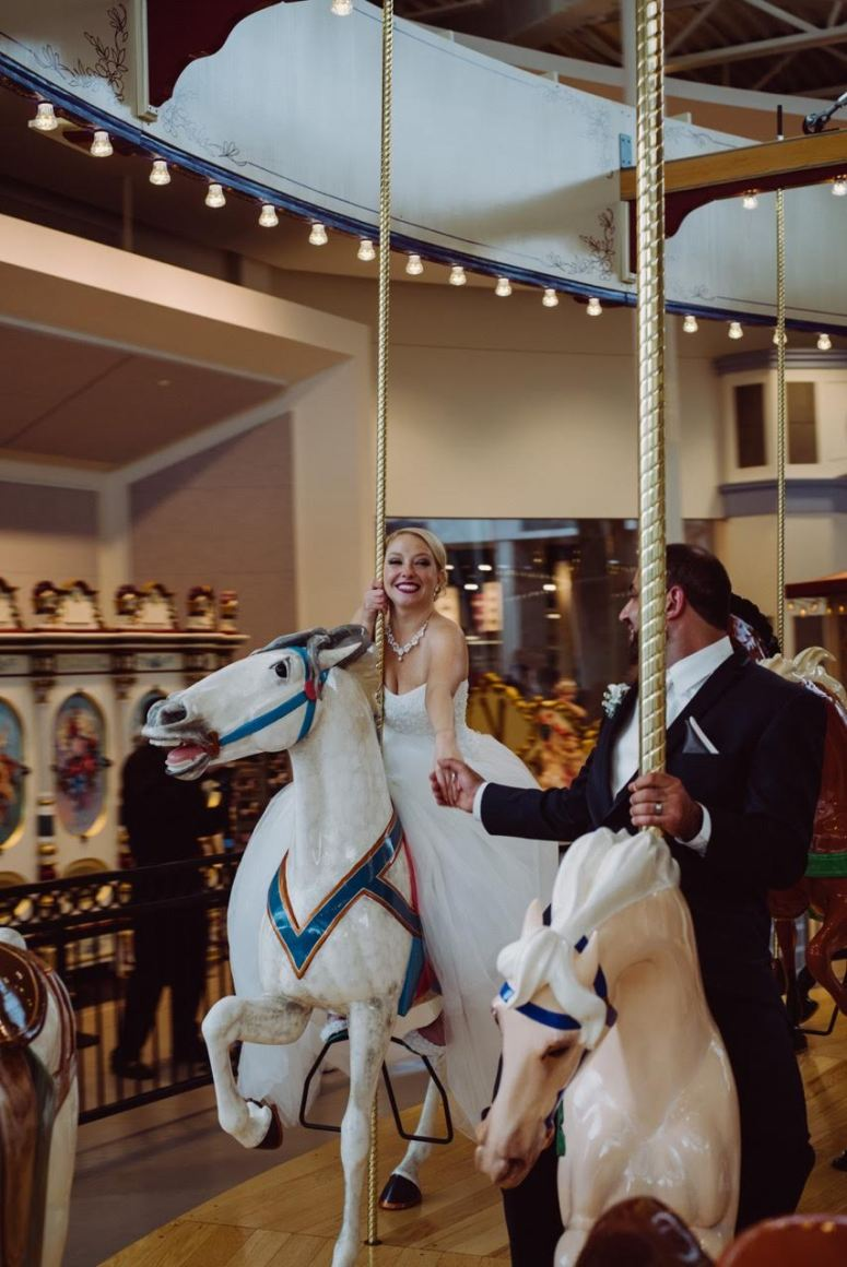 Bride and Groom on Carousel on Wedding Day