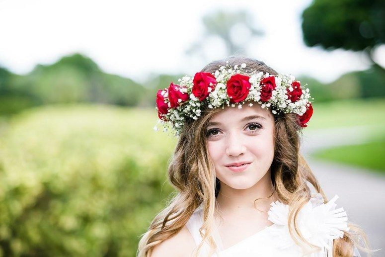 Flower Girl Wearing Floral Crown Made of Red Roses