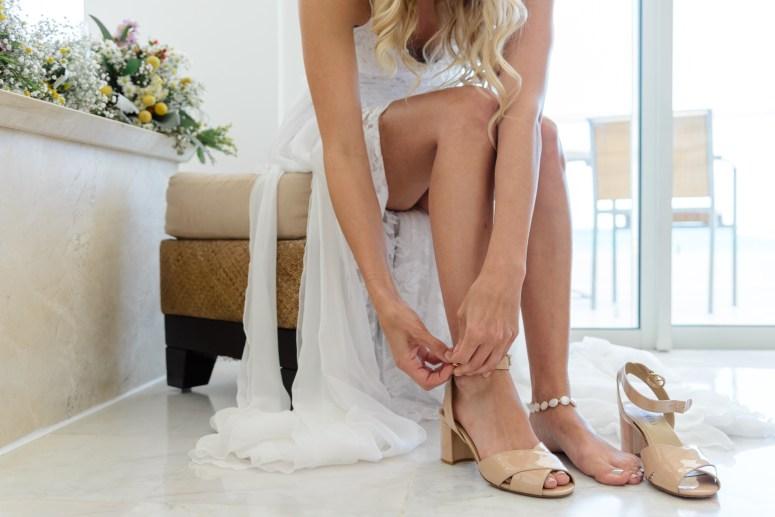 Bride dressing in Bridal Suite
