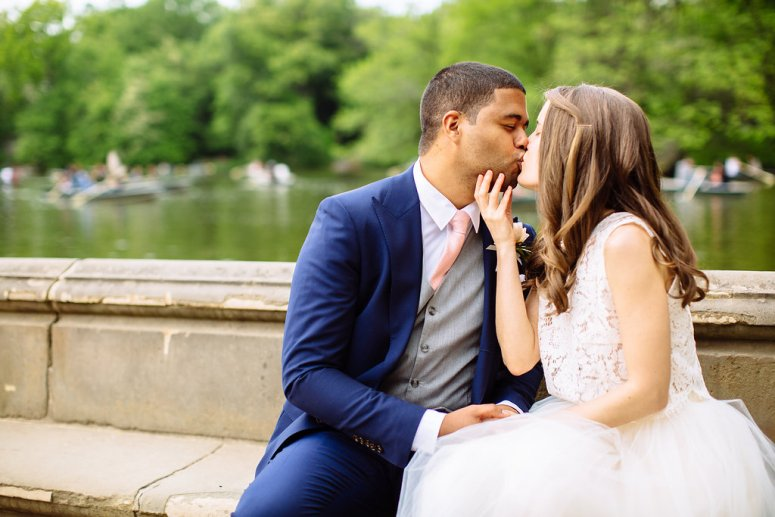 Bride and Groom kissing on bench in Central Park