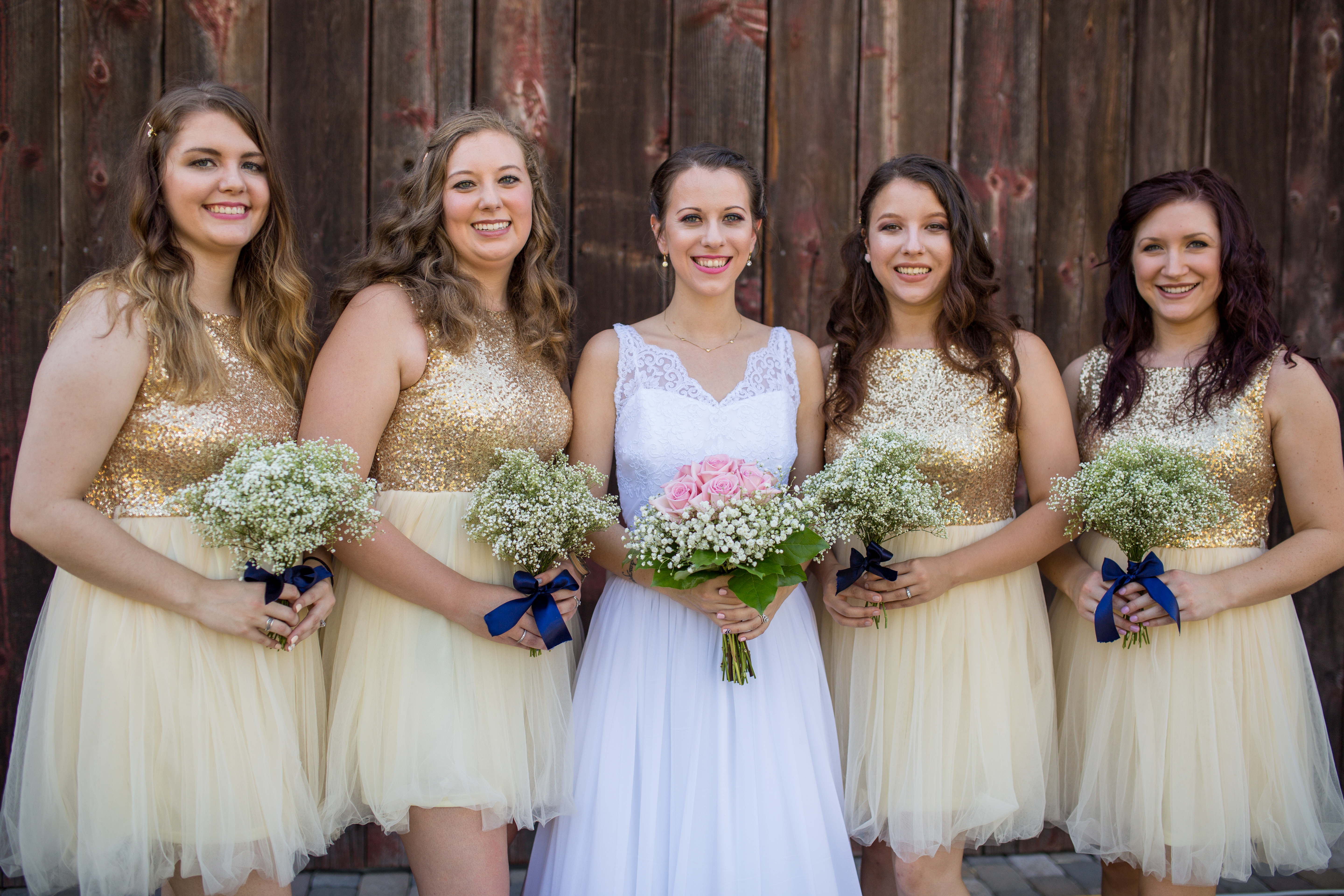 Gold sequin bridesmaids gowns with baby breath bouquets