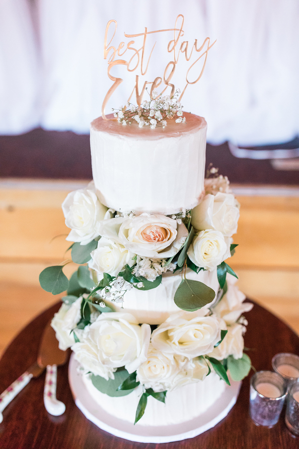 Three tier wedding cake with fresh florals