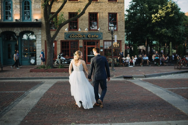 bride and groom in front of aster cafe in minneapolis
