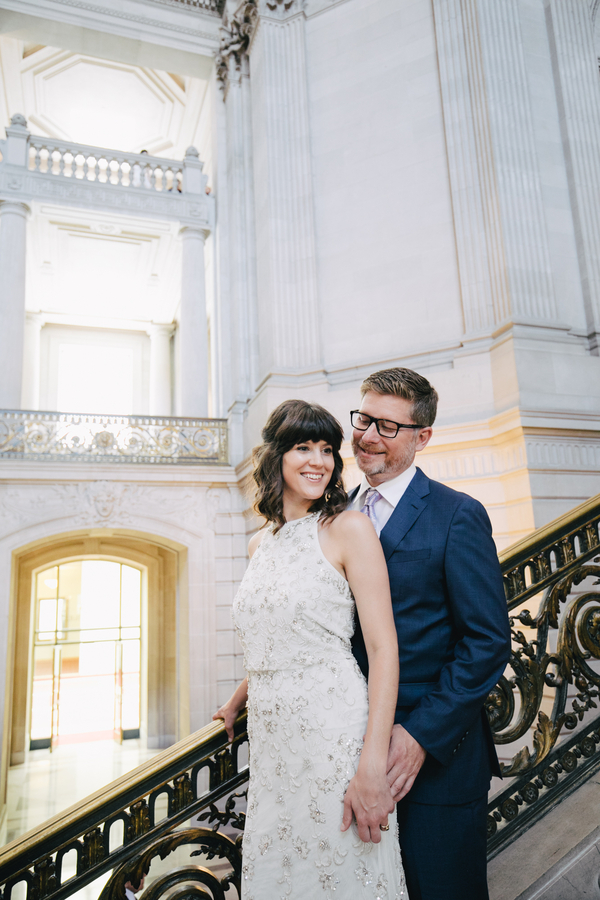 Bride and Groom on steps of San Francisco City Hall