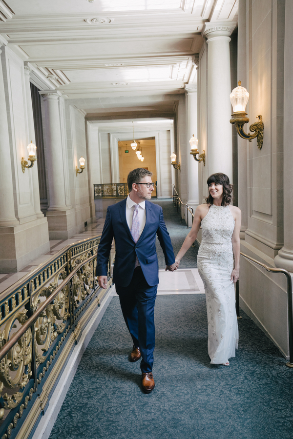Bride and Groom Holding Hands in City Hall